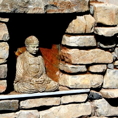 Buddha in stone wall